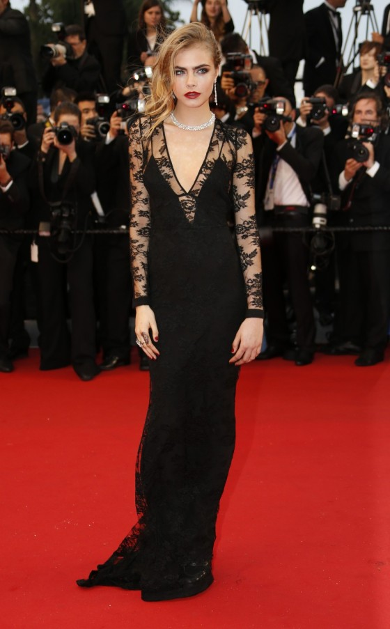 370519-model-cara-delevingne-poses-on-the-red-carpet-as-she-arrives-for-the-s